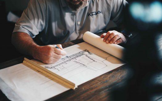 Man sketching architectural plan